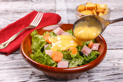 salad with cheese sauce