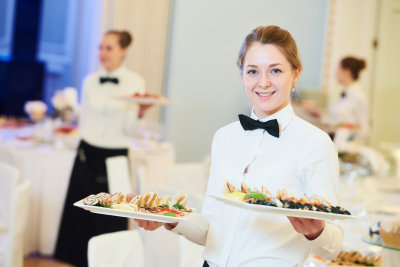 Young woman with food on dishes